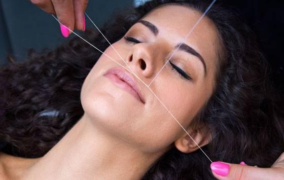 Удаление волос с верхней губы с помощью нити